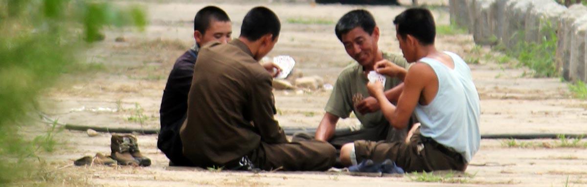 Korean workmen playing cards during lunch break