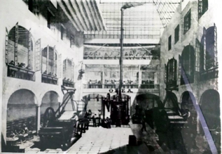 interior view of the Olea playing card factory showing steam-powered presses and workers engaged in the various stages of manufacture, late 19th century