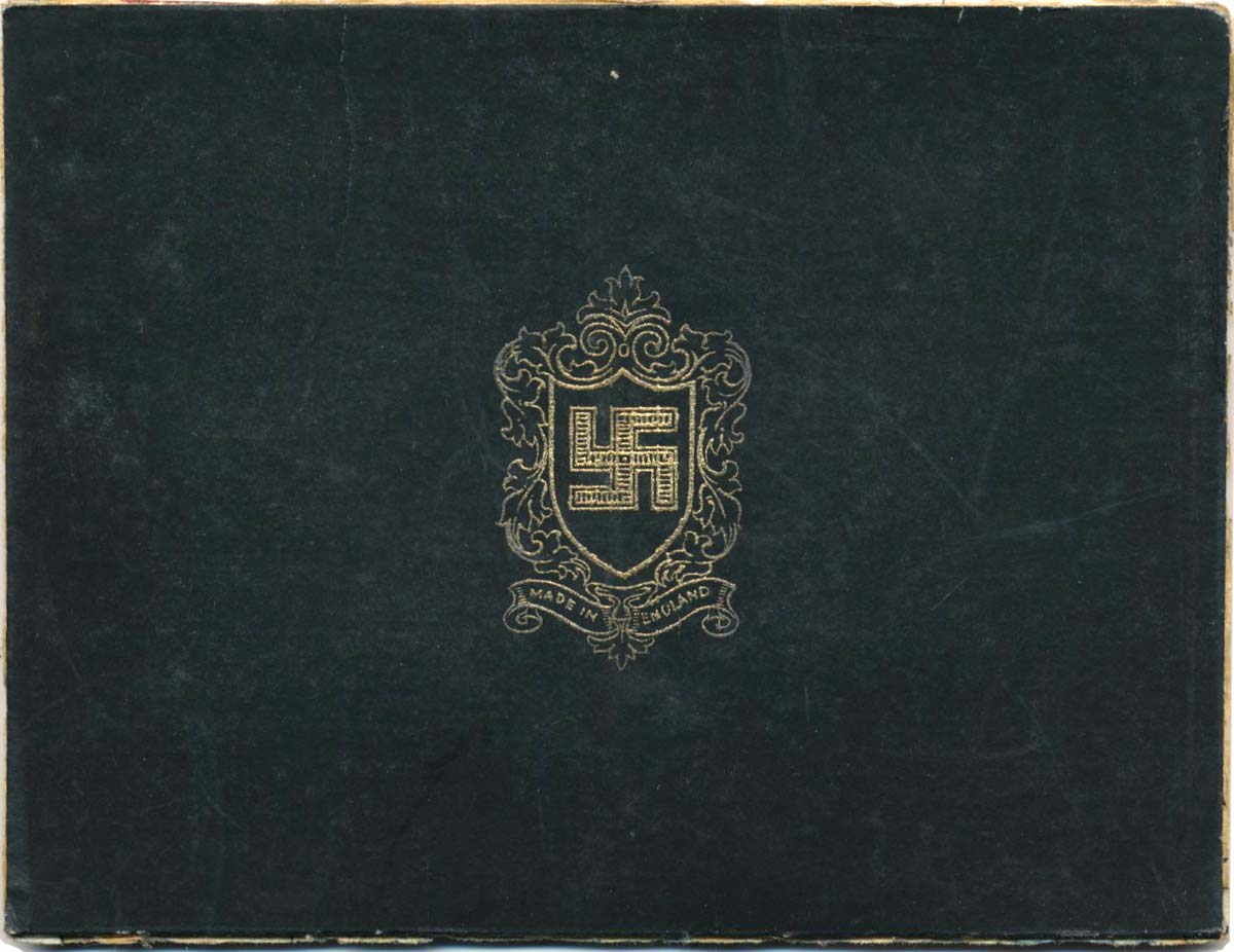 inside of the lid of a box produced by Thomas De La Rue with a swastika design, c.1934